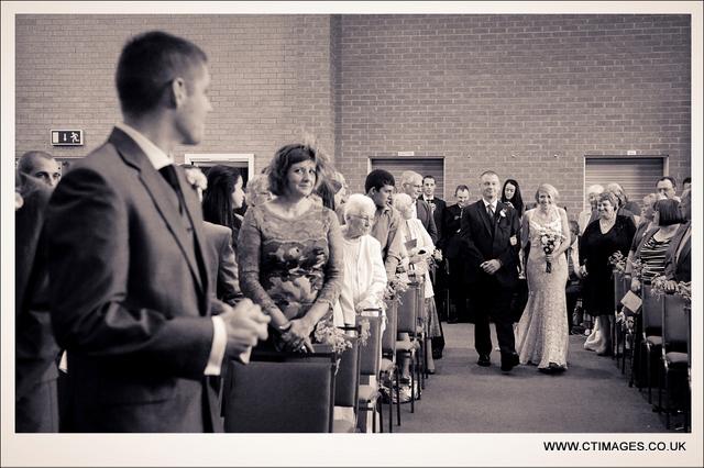 rivington-hall-barn-weddings-photographers-groom-sees-bride