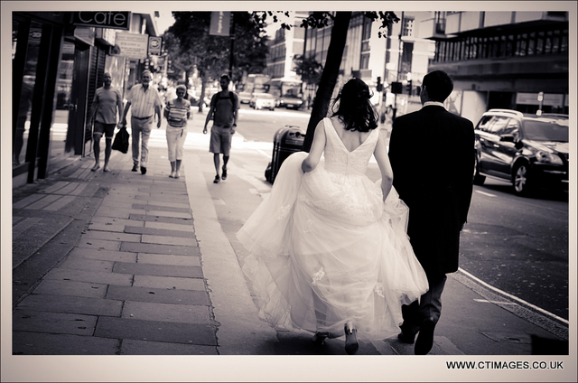 manchester-wedding-photography-couple-walking-through-streets