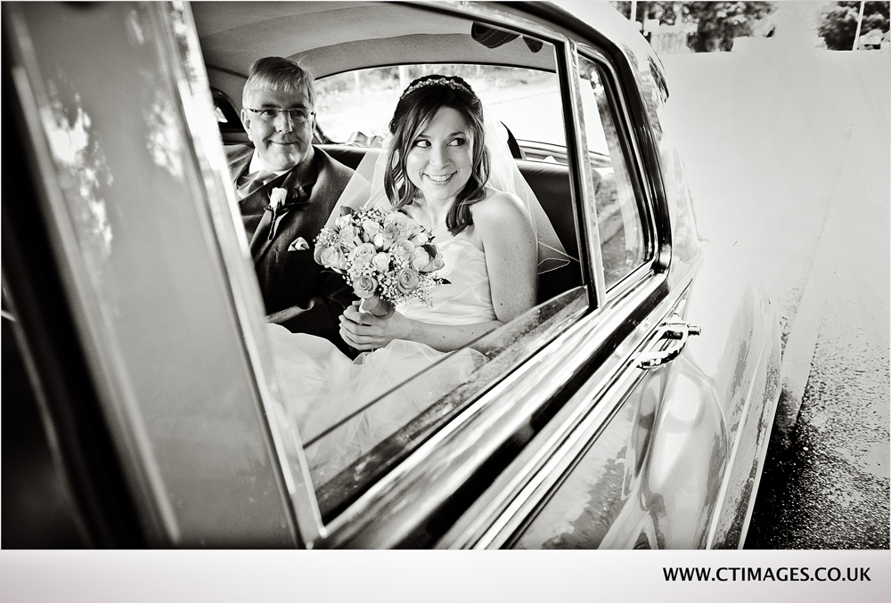 photography-of-bride-arriving-in-car-at bury-wedding