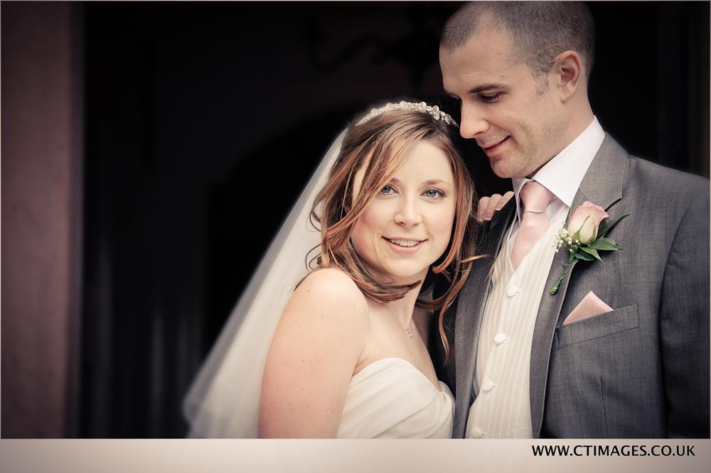 wedding-couple-pose-for-photographer-at-bury-wedding