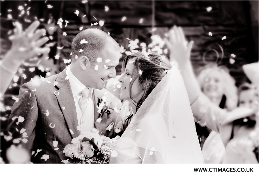 throwing-confetti-at-bury-wedding-for-photographer