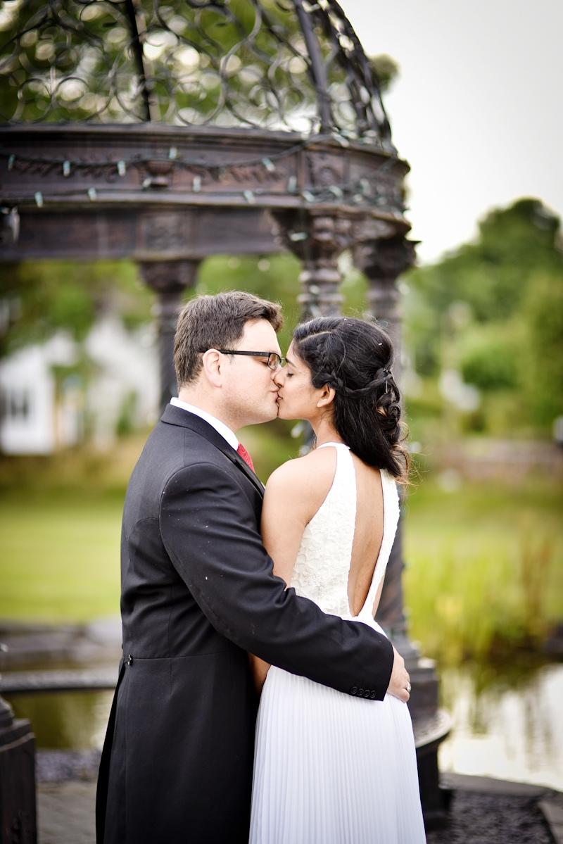bride and groom kissing at wedding alderley edge