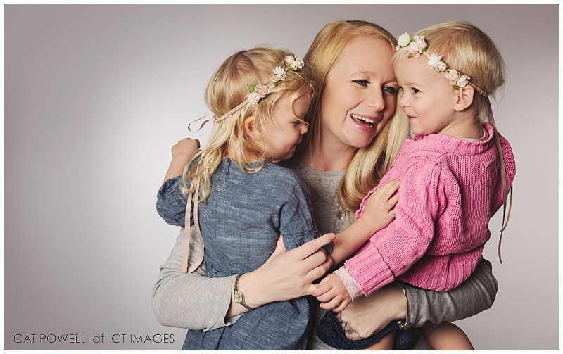 mom daughters pink and blue photograph