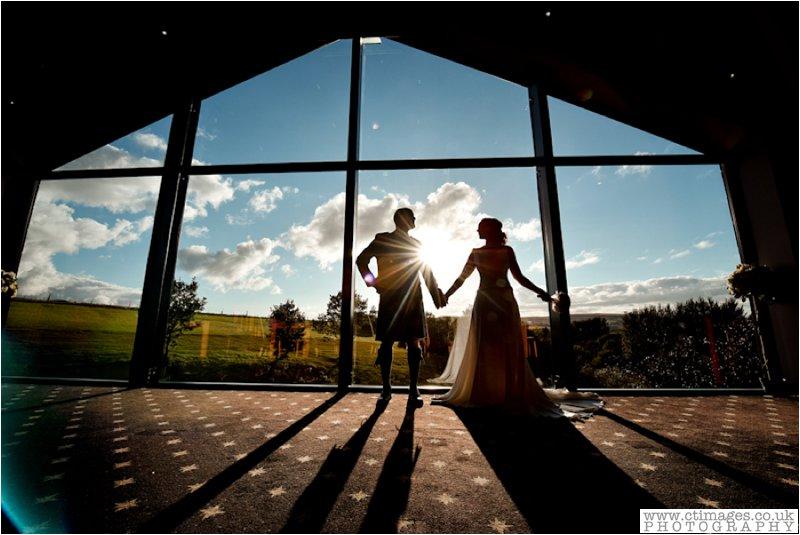fishermans retreat wedding bride and groom at window