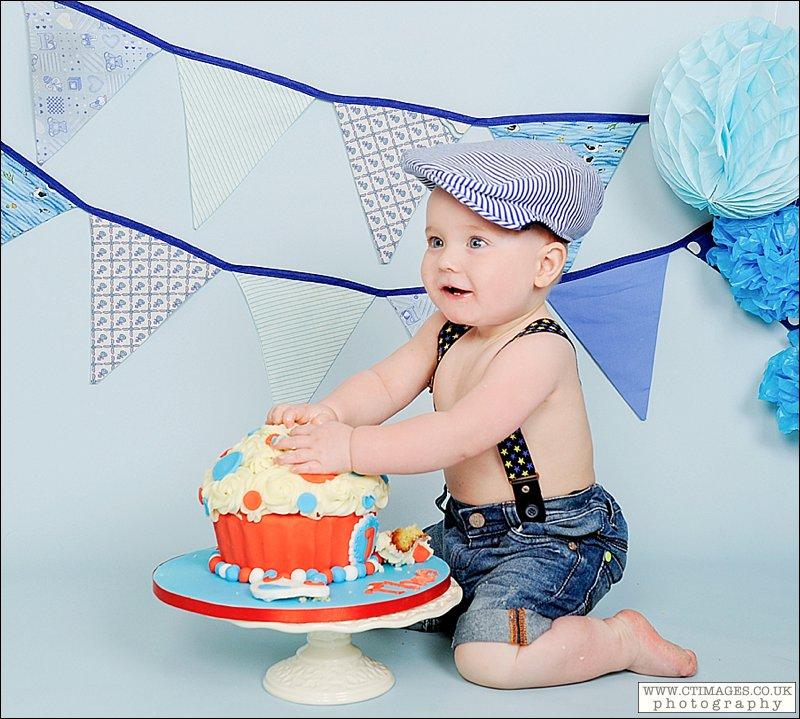 babys first birthday,cake smash photography,manchester cake smash photography, baby boy, flat cap, braces